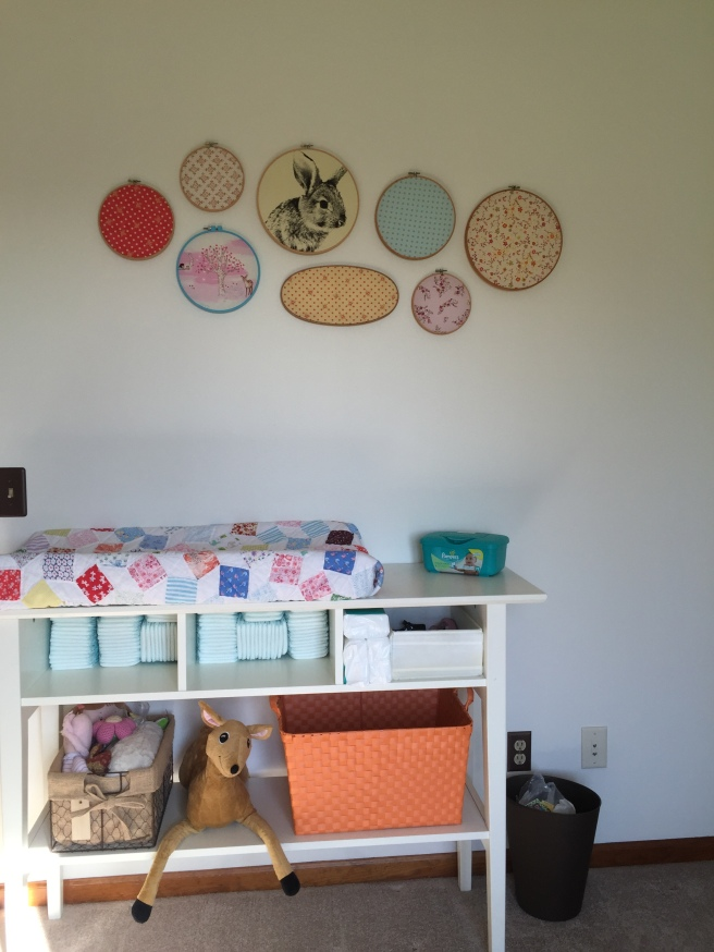 I used an old quilt to cover the changing pad and used embroidery hoops to display fun fabrics.