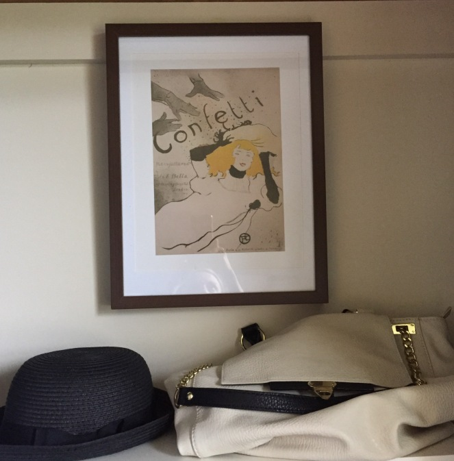 I used an old frame and an old poster I had hanging around as decoration and put my hat and favorite purse on top of the shelf to add some glam.