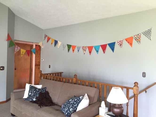 I pulled out this amazing, handmade bunting from Frederick's first birthday. I cut off the