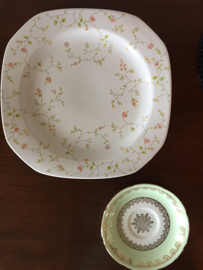 I think I'm going to use the big plate (it cost $0.49) under a pot to catch water or to hold candles. The small bone china plate ($0.99) is going to hold jewelry.