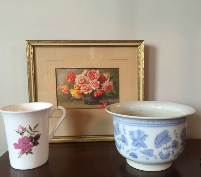 I have been looking for unique, pretty art work and this painting for $2 stole my heart. I also love drinking tea out of bone china and this taller mug for $1 is perfect! The pattern on the pot really grabbed my eye - now to get planting!