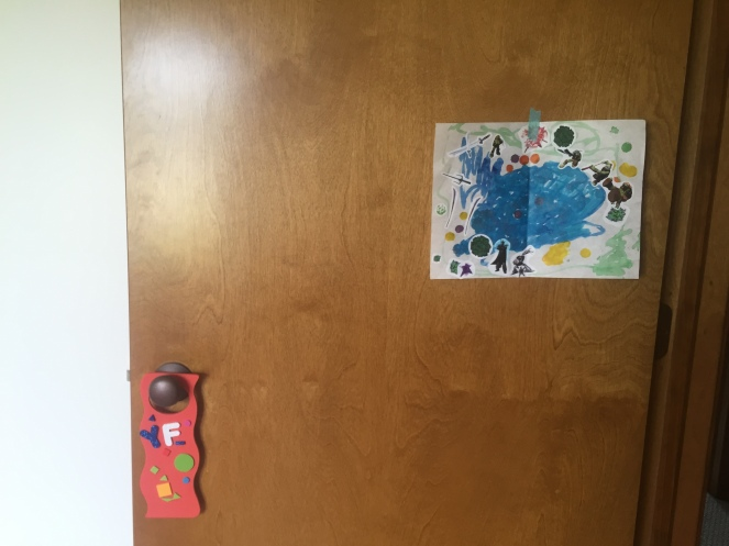He wanted to decorate his door with some art. The painting is from one of his friends - I love watching little kid friendships blossom!
