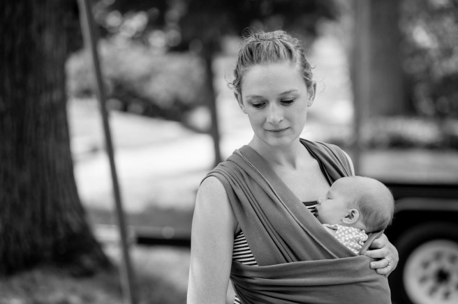 My neighbor toke this photo. It was a warm summer day and I was sweating profusely while wearing Edie. She loved every minute of sleep in this wrap. I think she's around 4 weeks old here and I've succumbed to her strength and need to be worn while sleeping during the day. (Not pictured are the tears I shed just wanting a break to snuggle my 2 year old without having my 1 month old strapped to me - mom guilt big time started to kick in! Guilt for desiring a break and guilt for not spending quality time with Frederick)