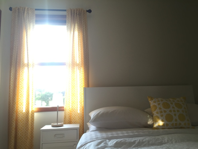 The one thing I love about painting our bedroom white and having yellow curtains is the vast variety of light and color that comes into the room depending on the time of day and placement of the sun. This was taken early evening.